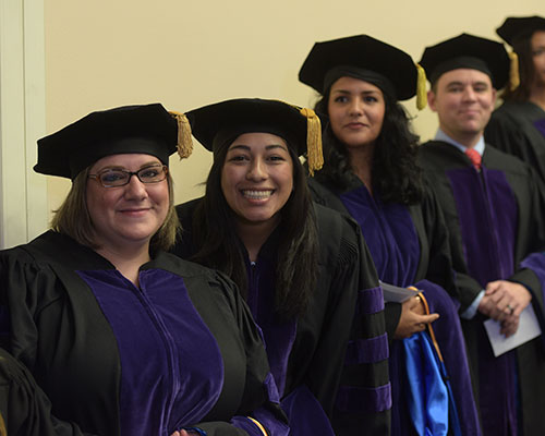 School of Law students await hooding at a ceremony.