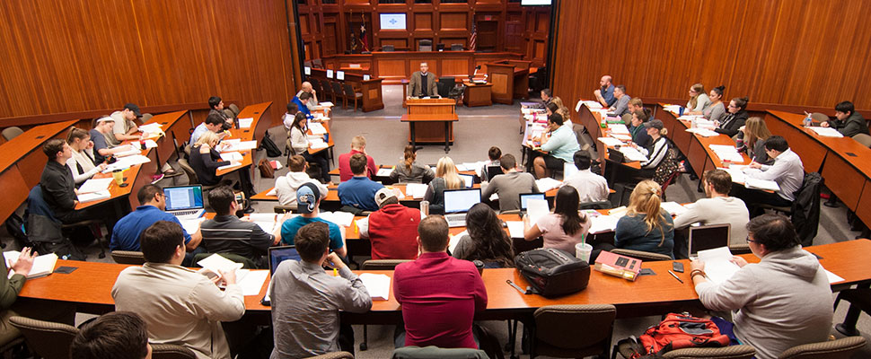 Professor Colin Marks teaches class in the law courtroom.